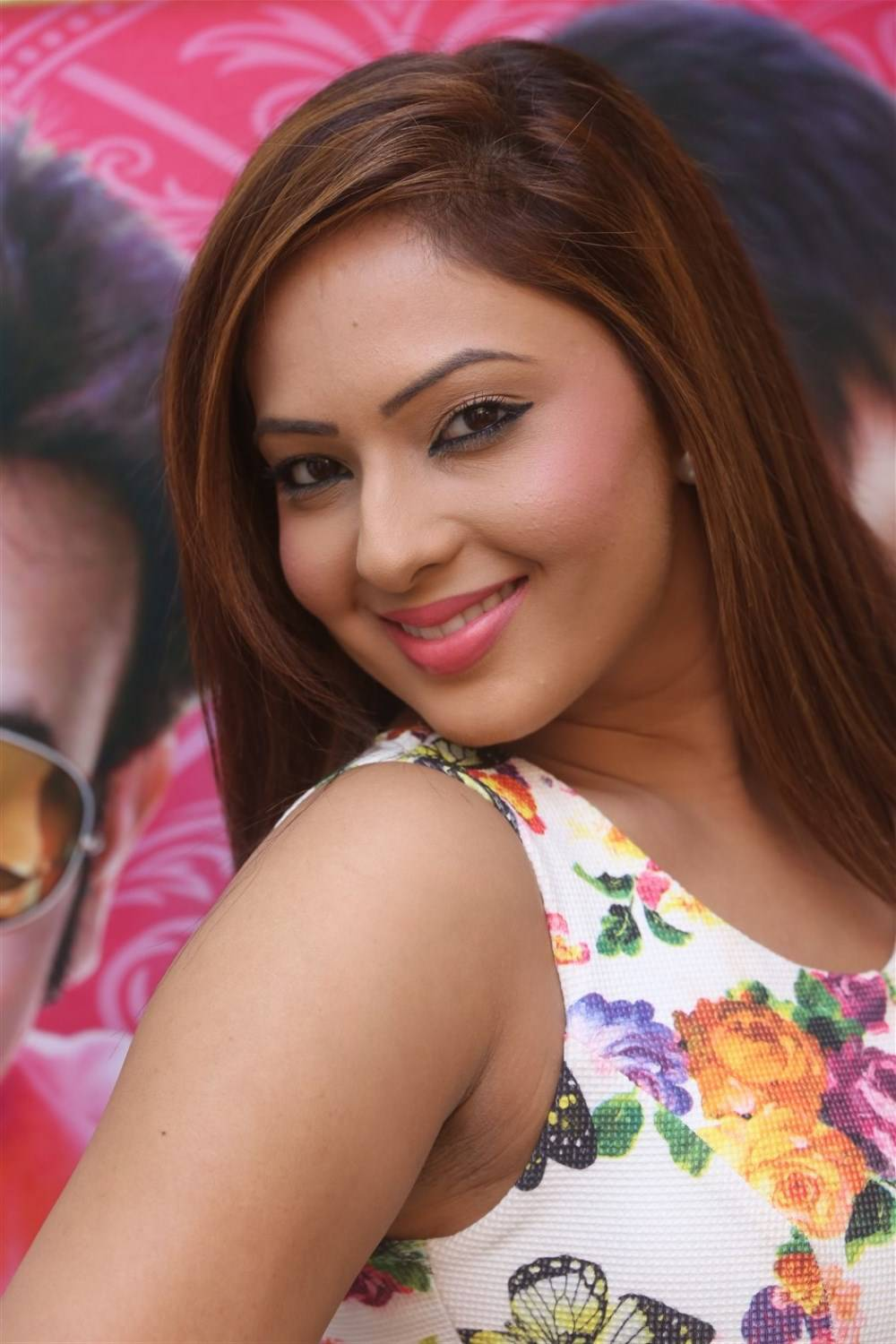Actress Nikesha Patel Smiling Face In White Dress At Movie Interview