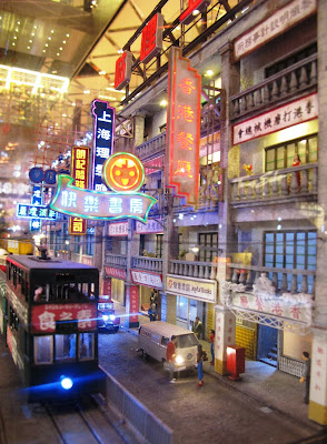 Model Hong Kong street scene with neon lights .