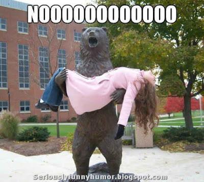 bear-statue-holds-woman-screams-noooo