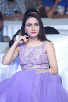 Actress Dhriti Pos in Purple Lehnga Lehenga Choli at Keshava Telugu Movie Audio Launch .COM 0001.jpg