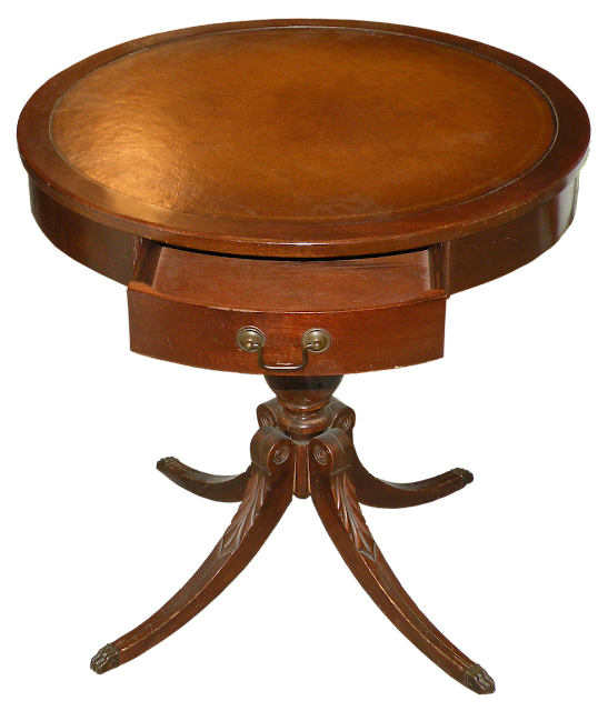 A round side table with  Duncan Phyfe legs, a small door and a pretty leather top.
