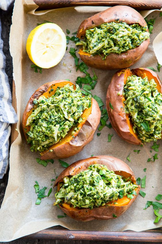 These chicken pesto stuffed sweet potatoes are seriously tasty, filling and easy to make!  A paleo and Whole30 compliant pesto is mixed with shredded chicken and tops perfectly baked sweet potatoes.  Great to make ahead of time and the leftovers save well!