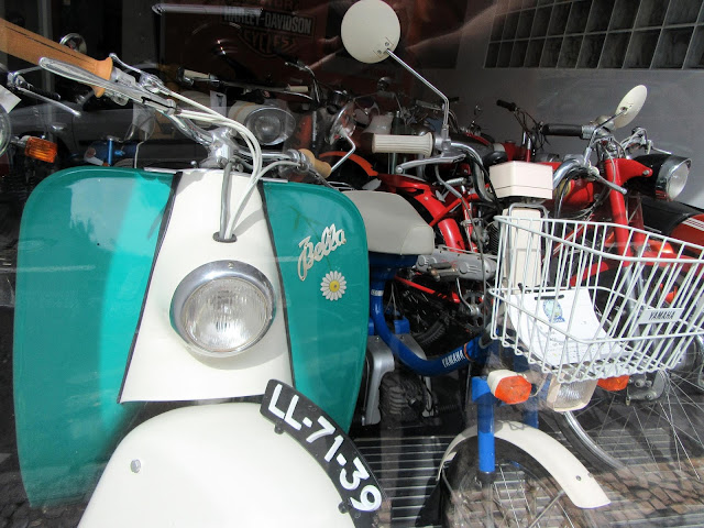 collection of motorcycles at a store