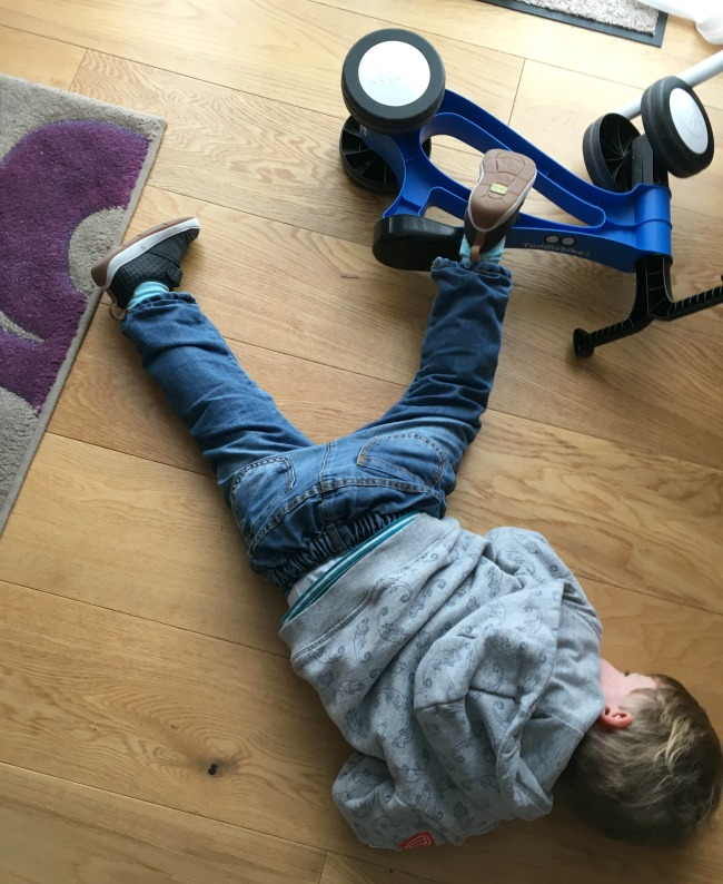 our-weekly-journal-13-feb-2017-toddler-laying-on-floor-with-leg-over-fallen-bike