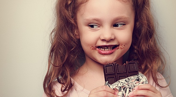 Cute Baby Girl Eating Chocolate
