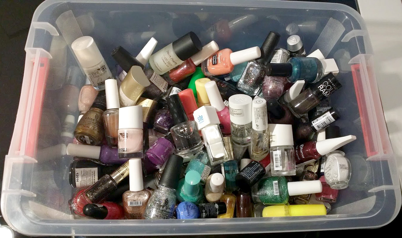pile of nail polish clutter in a bin
