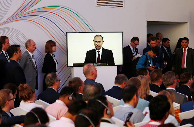 Image Attribute: Russian President Vladimir Putin is seen on a television screen as he speaks during a joint news statement after India-Russia Annual Summit in Benaulim, in the western state of Goa, India, October 15, 2016. REUTERS/Danish Siddiqui