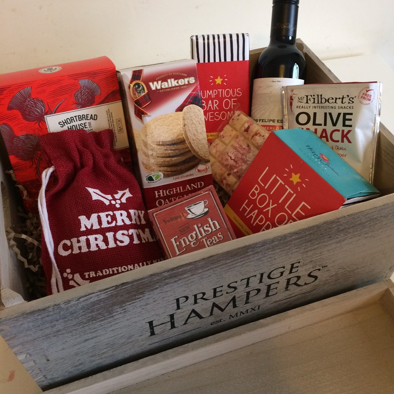 They grow so quick christmas tradition from prestige hampers the christmas tradition hamper arrived well packaged in a cardboard box with bubble wrap for protection the hamper itself is a stylish vintage style wooden solutioingenieria Choice Image