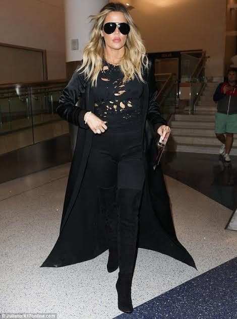 Would you rock Khloe Kardashian's ripped T-shirt? (photos)