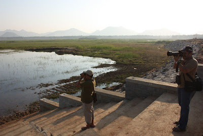 Birdwatchers at Tumkur Amanikere wetland in 2013. The Tumkur Amanikere has retained a big part of its waterbody after the renovation.
