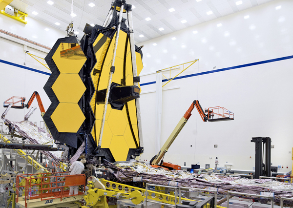 Engineers work on NASA's James Webb Space Telescope at the Northrop Grumman facility in Redondo Beach, California.