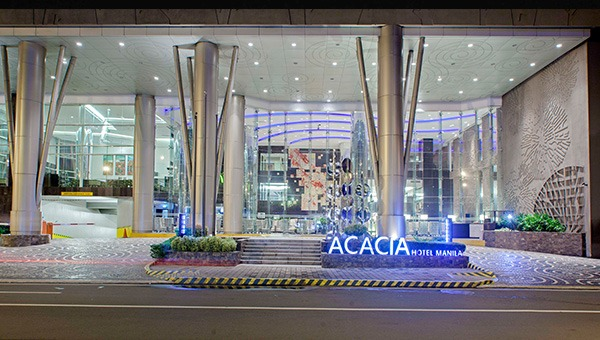 The facade and main lobby of Acacia Hotel