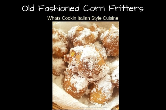 these are an old fashioned corn fritter shaped like donut holes with powdered sugar on top in a wicker basket lined with white paper towels. These corn fritters are eaten warm rolled in sugar.