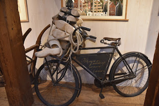 Antique bicycle loaded with unfinished wooden clogs, Zaanse Schans, Zaandam, The Netherlands