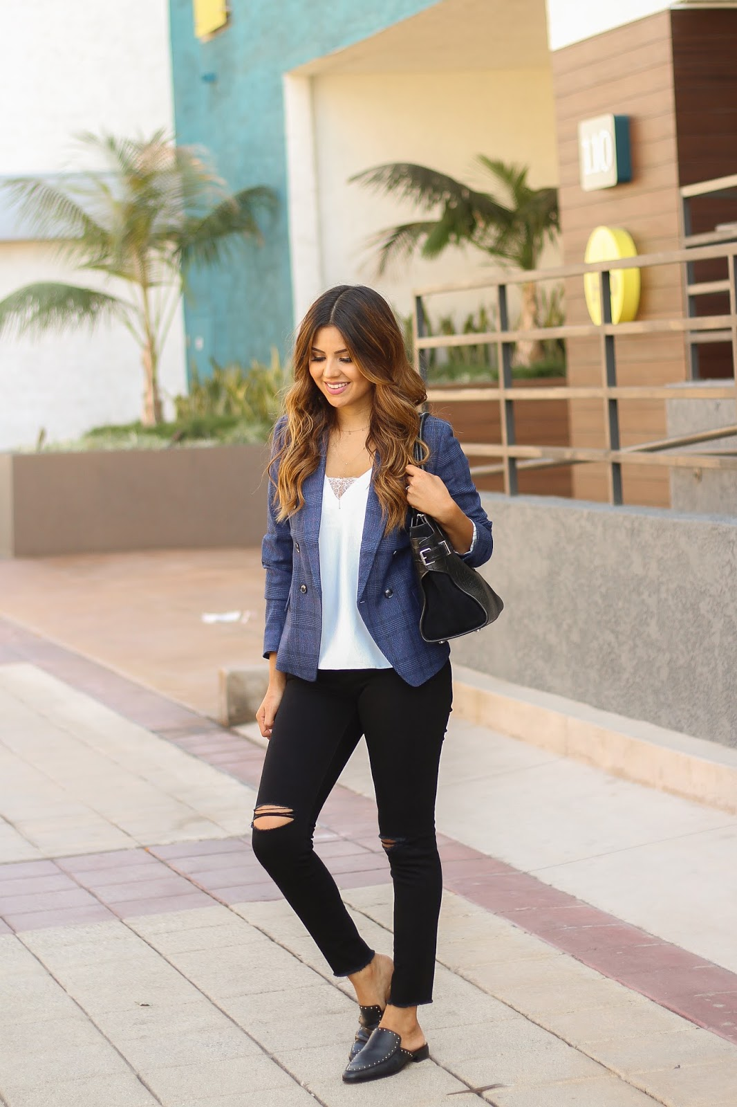 Blue plaid blazer with Black distressed jeans and studded slides