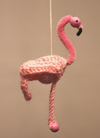 http://www.ravelry.com/patterns/library/miniature-flamingo-africa-series