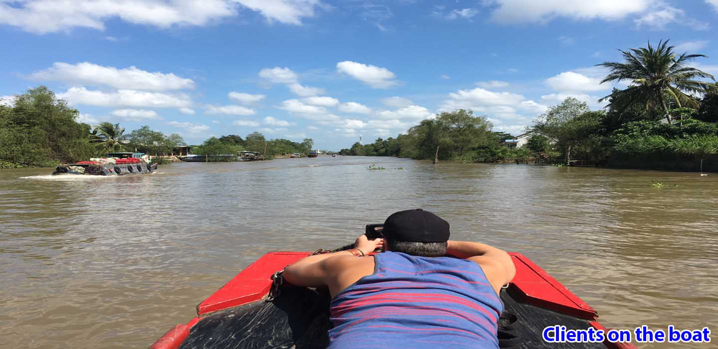 real-mekong-delta-tour-Clients-on-the-boat