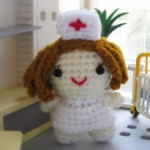 https://www.lovecrochet.com/little-nurse-german-translation-free-amigurumi-doll-crochet-pattern-crochet-pattern-by-sayjai-thawornsupacharoen