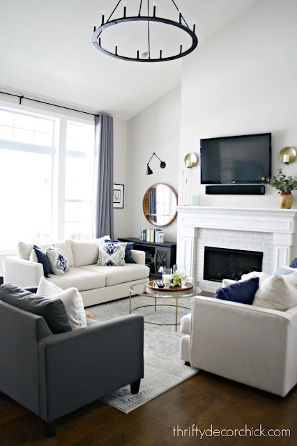 family room with pitched ceiling and big windows