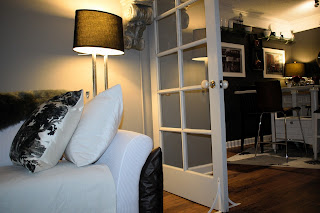 How to create a nook in a small living area; white sofa cover;JoFer Interiors