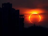 2012 annular solar eclipse seen at sunset near buildings