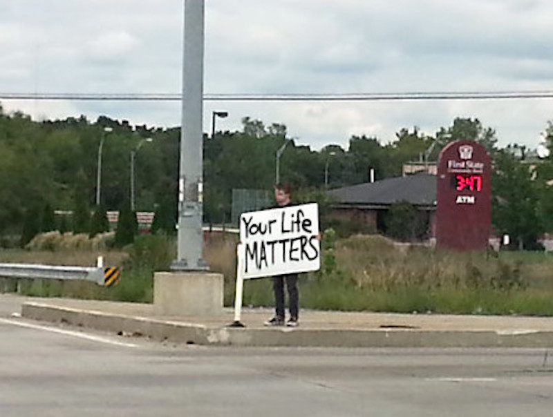"Standing on the corner with a sign ""Your Life Matters."" More of this guy! marchmatron.com"