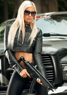 Blonde girl in leather with a gun