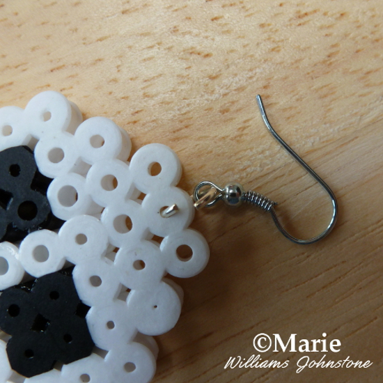 Making jewelry earrings using fused Perler Hama bead embellishments craft