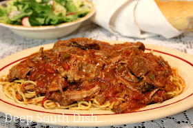 Spaghetti Daube is a well loved Deep South dish and not surprising because it is such a budget stretcher. A slow braised beef, it is cooked in, then shredded & returned to a lovely Creole sauce. Serve over spaghetti noodles.