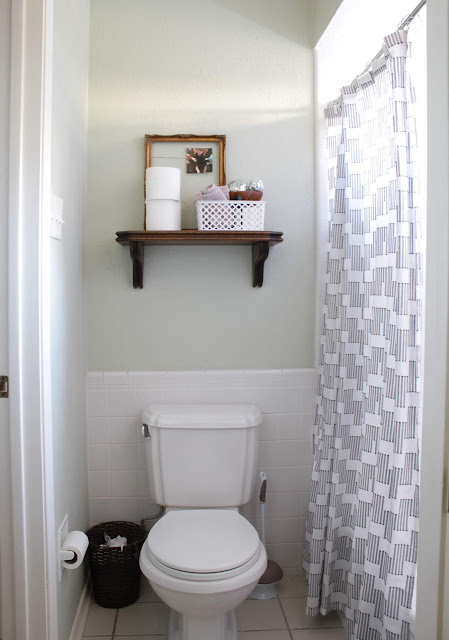 I'm making over our bathroom. Besides new lighting and hardware I'm using what we've got. I'd love to make due with most of what we already have to inspire you to make an original bathroom pretty for now and not just hate it until you replace it. #bathroommakeover