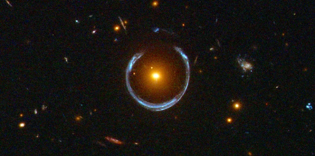 The Cosmic Horseshoe, as photographed by the Hubble Space Telescope. Photo credit: ESA/Hubble & NASA.