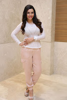 Kyra Dutt in Tight White Top Trousers at Paisa Vasool audio success meet ~  Exclusive Celebrities Galleries 003.JPG