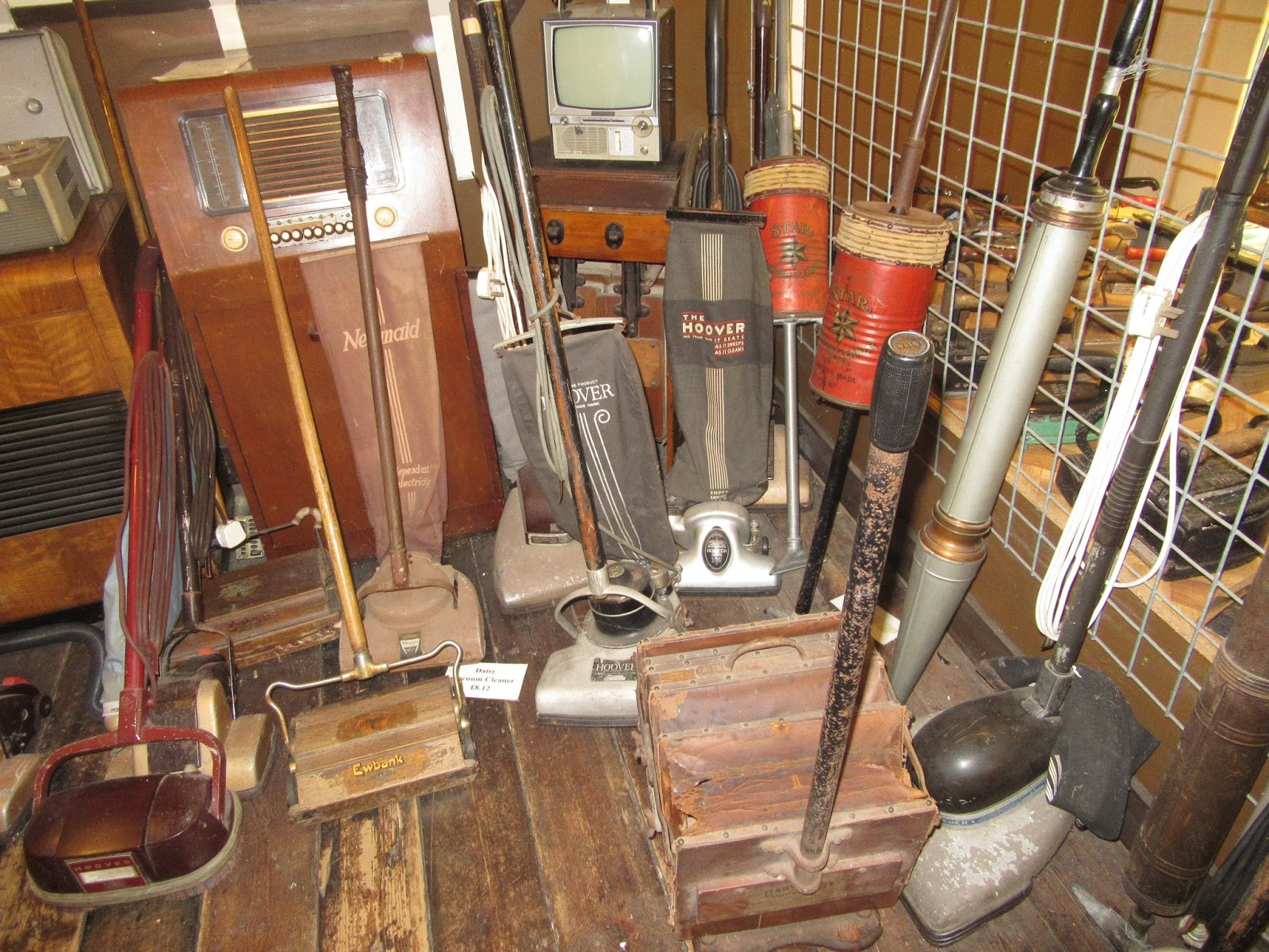A collection of vacuum cleaners throughout the years