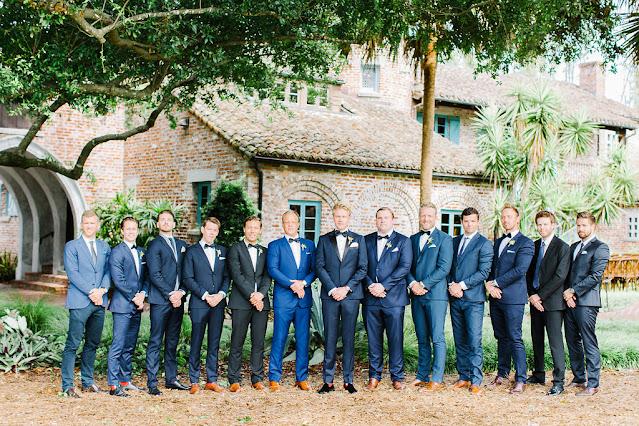 groomsmen in blue tuxedos