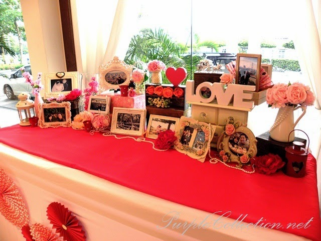 photo booth, sakura, cherry blossom, red, pink, gold, theme, wedding decoration, holiday inn kuala lumpur, glenmarie, subang, shah alam, decorator, online, website, package, affordable, bird cage, love birds, stage backdrop, red carpet, peony, welcome board, sakura tree, LED lighting, grab a prop and strike a post, props, photo taking, bride, groom, red roses, teddy bear, petals, photo album viewing table decoration, paper fans, photo frames