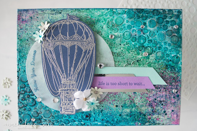 This mixed media canvas was created using a variety of products from Fun Stampers Journey.  Rhinestones, Splashes and Silks combine on the colorful and sparkling background.  Featuring the Blue Skies Stamp Set, along with a sentiment from the Text Happy Stamp Set.