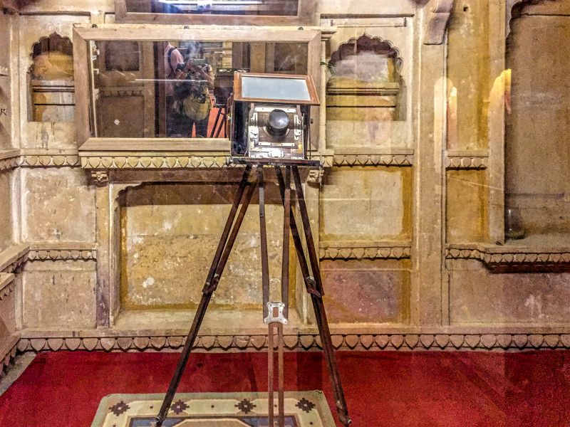 A Camera mounted on a tripod on display