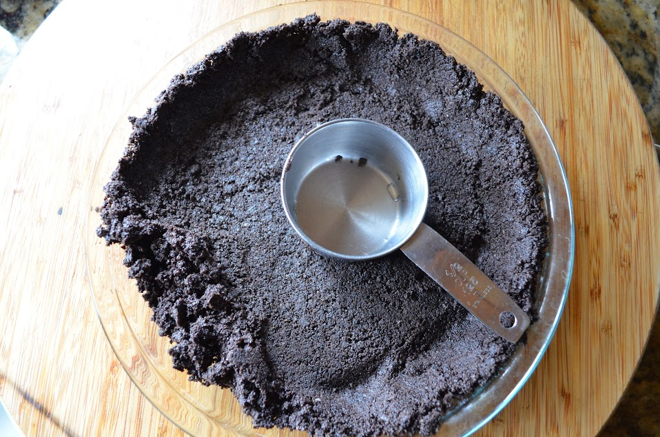 Grasshopper-Pie-With-Oreo-Cookie-Crust-Press-Crumbs-Into-Pie-Pan.jpg