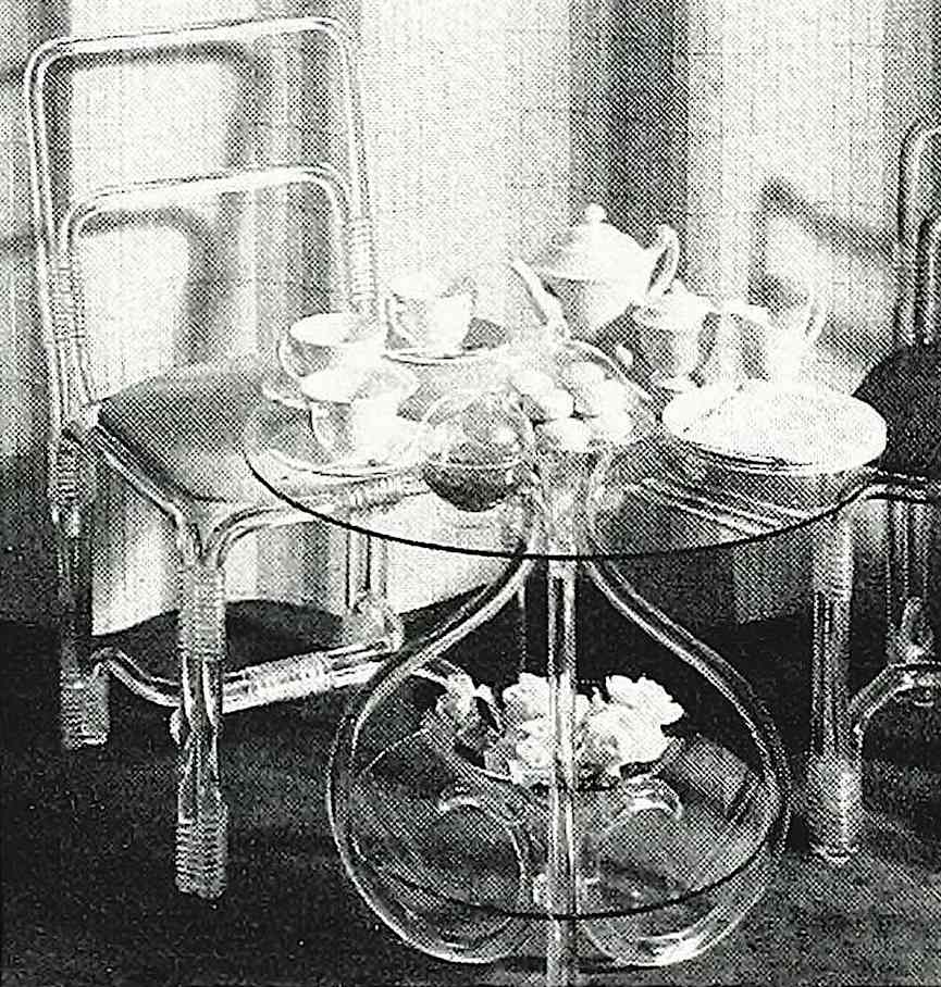 1948 clear plastic table and chairs, a photograph