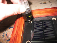 Install the tubes by inserting the center pin into the pre-drilled holes in the case