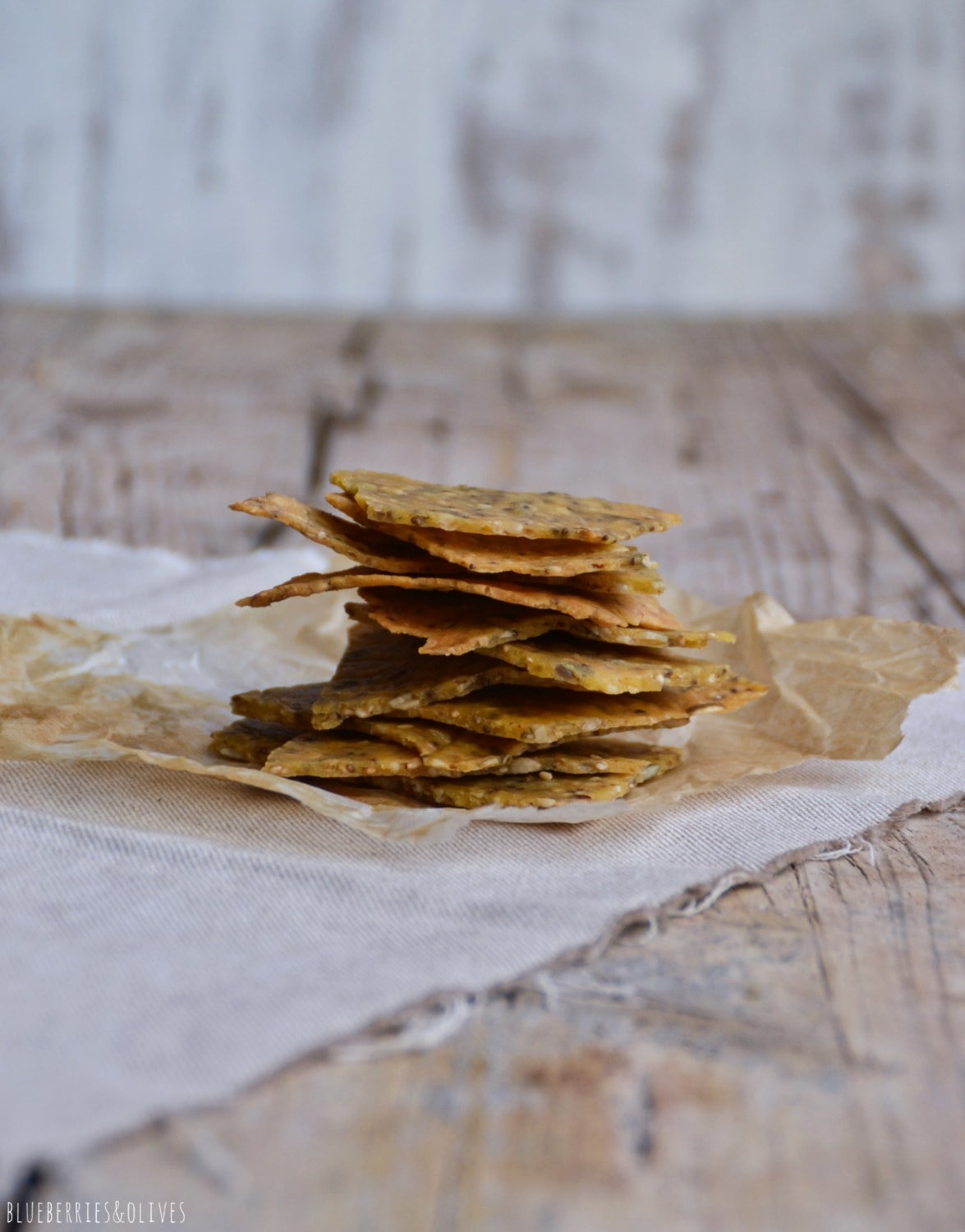 PILED CORN CRACKERS, WITH AN OLD WOOD BACKGROUND