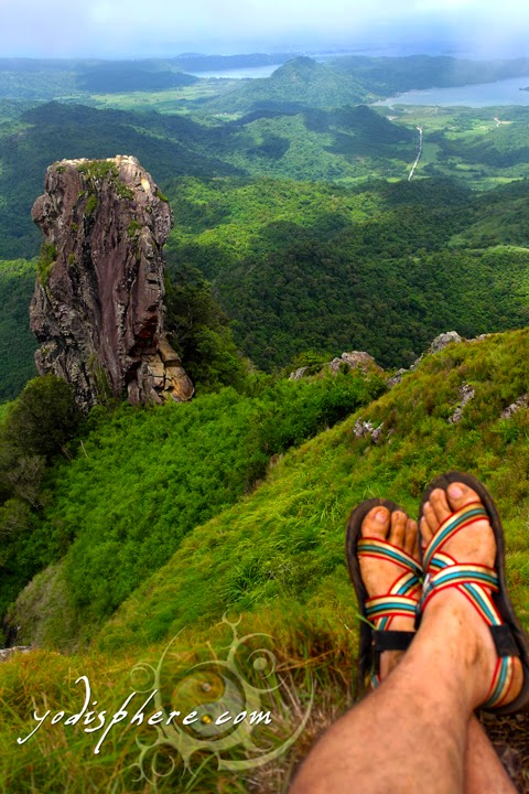 Tired and muddy feet resting and enjoying the view of the monolith at the summit of Mt. Pico de Loro  hover_share