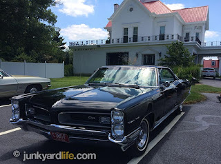 The big black 1966 Pontiac could not be missed with flawless paint and picturesque setting.