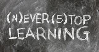 Never stop learning written on a chalkboard