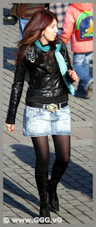 Girl in jean skirt and leather jacket