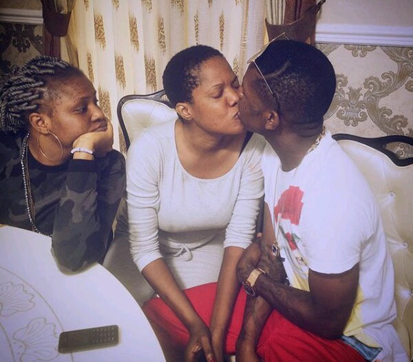 Caption this photo of Small Doctor kissing Toyin Abraham (Toyin Aimakhu)