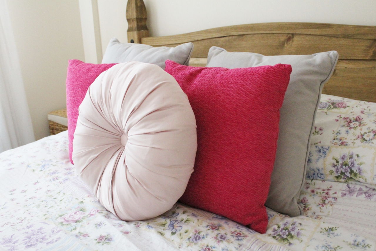 Pink and grey bedroom cushions