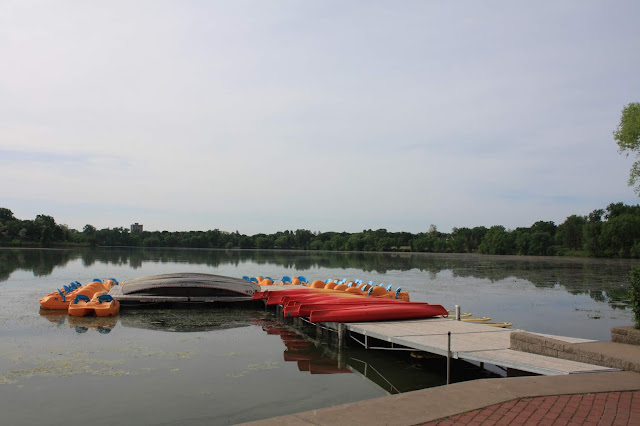 Paddleboats and kayaks rest at Como Lake