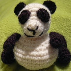 http://www.ravelry.com/patterns/library/fat-bottomed-panda-amigurumi