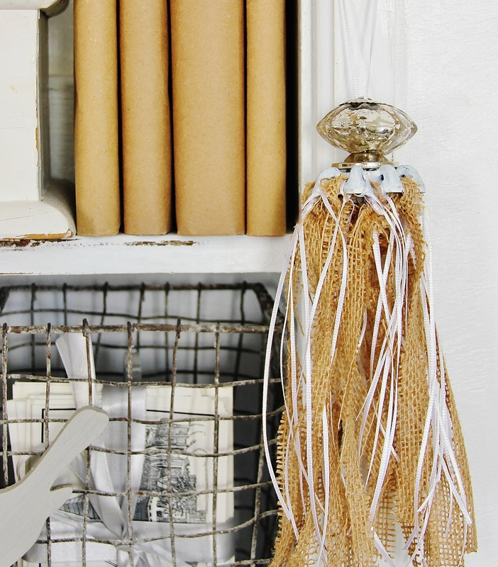 this decorative ornament is made from strips of burlap and ribbon